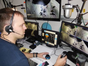 MUSC student Craig Kutz (2009, biology) uses a flight simulator as NASA tests his reactions to stress during a Human Exploration Research Analog mission.