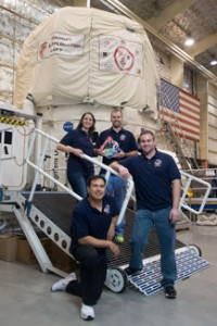 Craig Kutz (holding the mission patch) and his fellow crew members spent two weeks on a simulated mission to an asteroid.