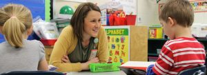 Liz Fritel, kindergarten teacher at Probstfield Elementary and this year's Probstfield Teacher of the Year, listens to a student read in a small group.