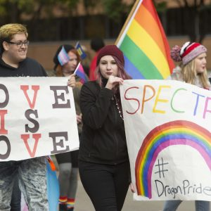 Students representing LGBTQ+ organization at MSUM Homecoming Parade